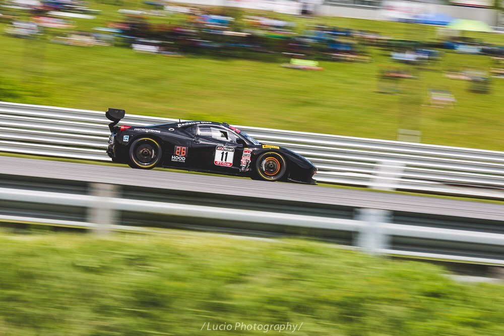Pirelli world challenge at lime rock park. Ferrari brakes glowing under hard braking.
