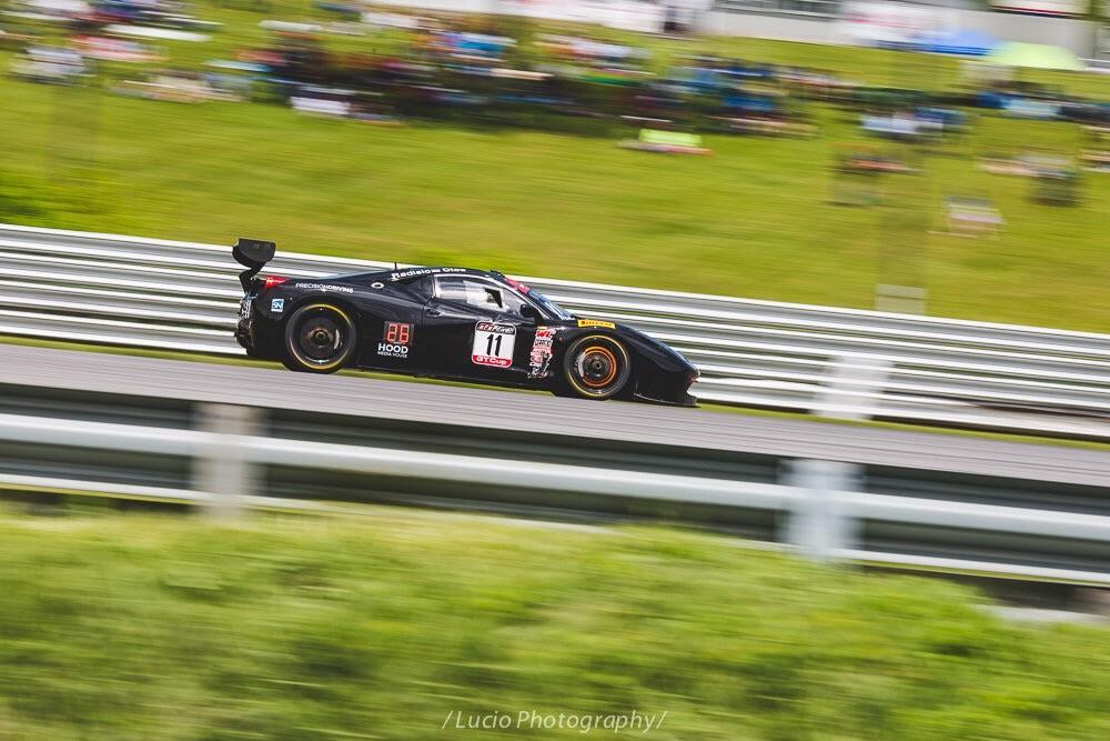 Pirelli world challenge at lime rock park. Ferrari brakes glowing under hard braking.